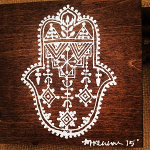 Hand painted henna on stained wood.
